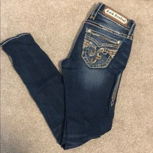 Rock revival skinny jeans with holes